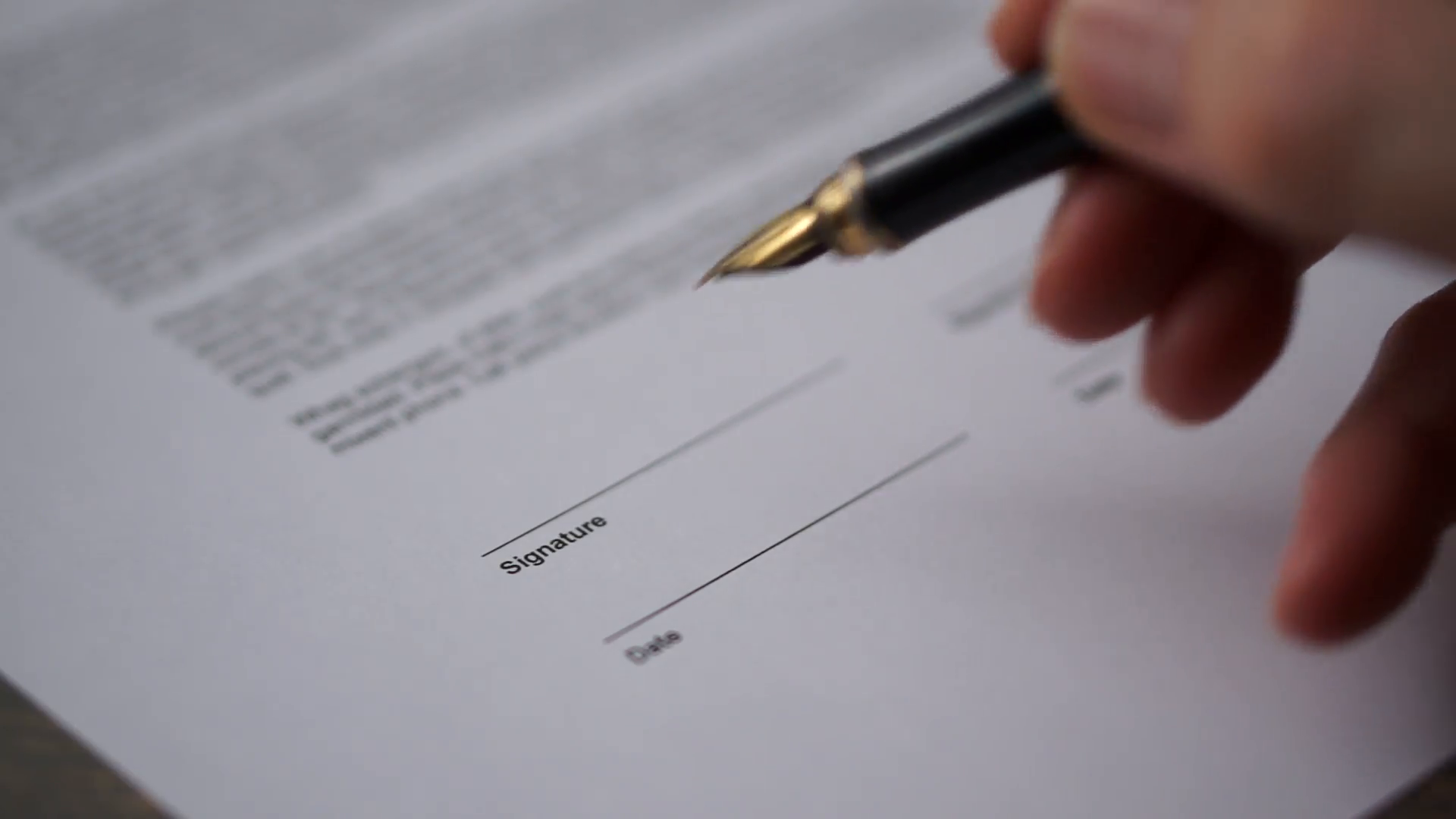 Client's hand while signing the contract